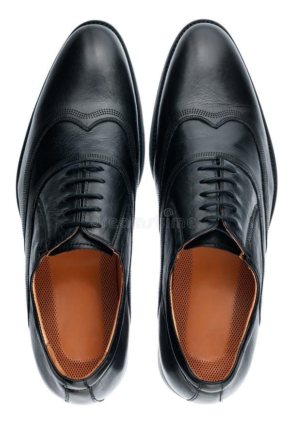 Sapatas de couro pretas masculinas clássicas isoladas em um branco fotografia de stock royalty free