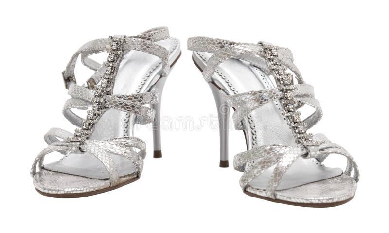 Sapatas de prata elegantes da mulher imagem de stock royalty free