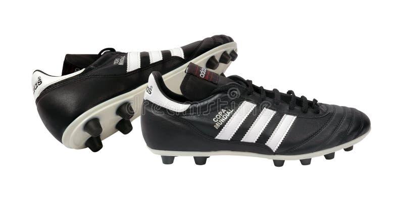 Sapatas do futebol de Adidas imagem de stock