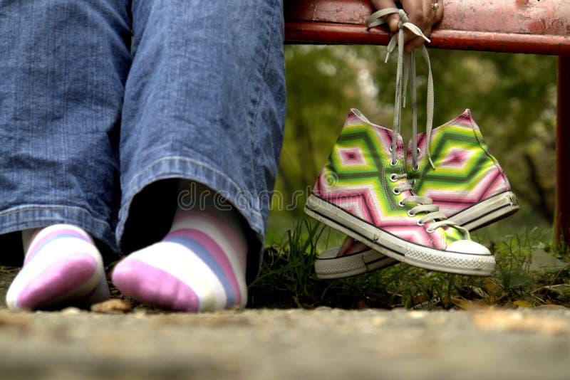 Sapatas e pés fotos de stock
