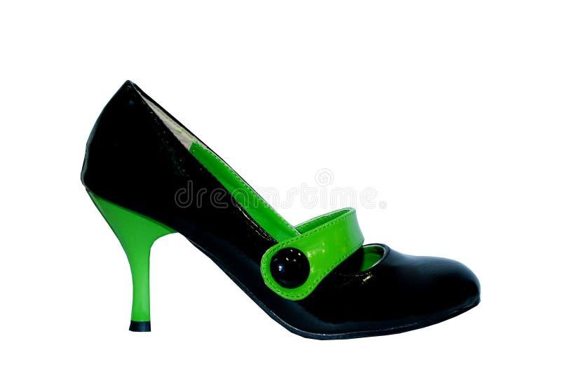 Sapatas verdes e pretas fêmeas no branco fotos de stock