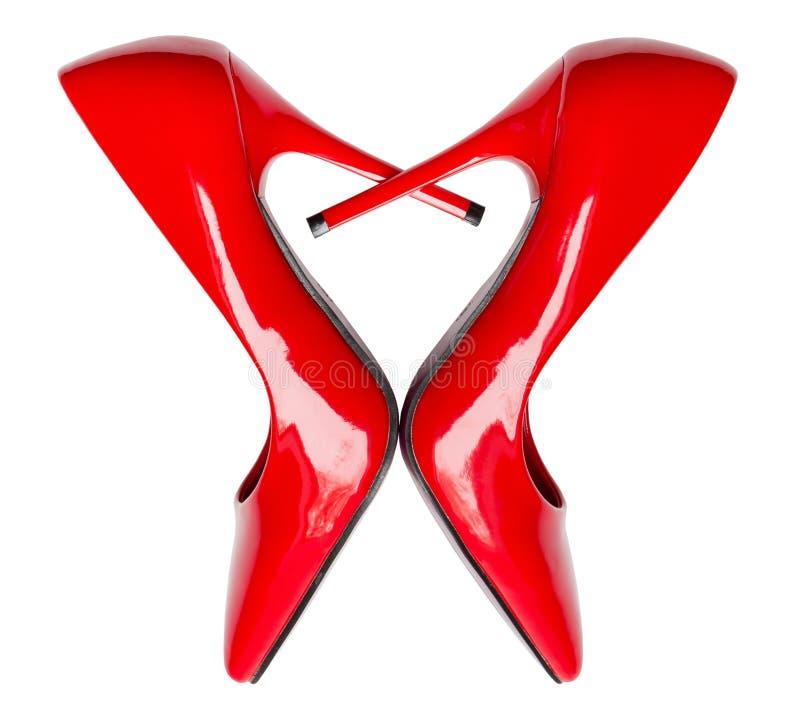 Sapatas vermelhas dadas forma coração do salto alto foto de stock