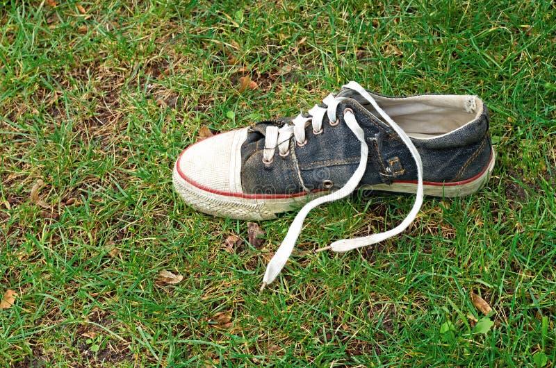 Sapatos de ginástica gastos imagem de stock