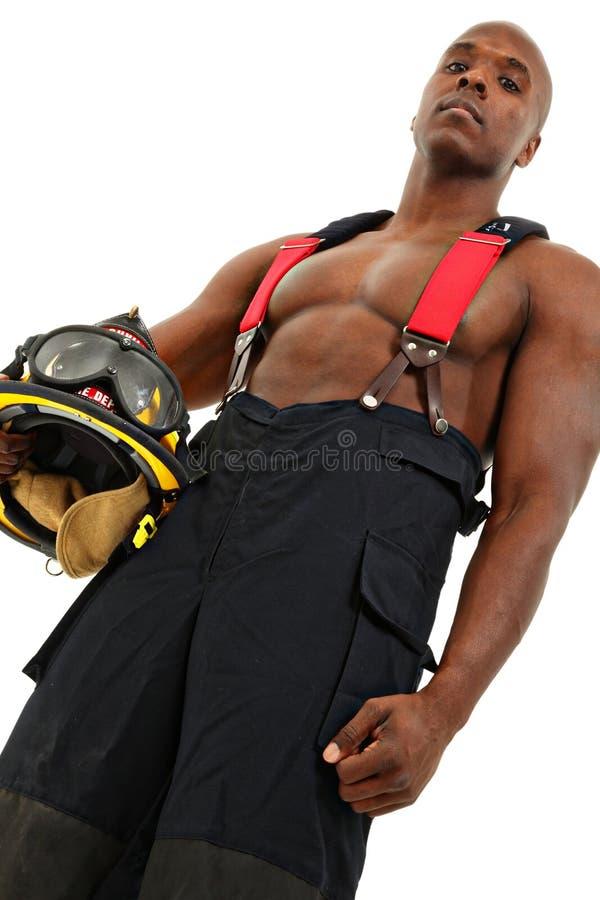 Sapeur-pompier attirant d'homme de couleur dans l'uniforme photo libre de droits