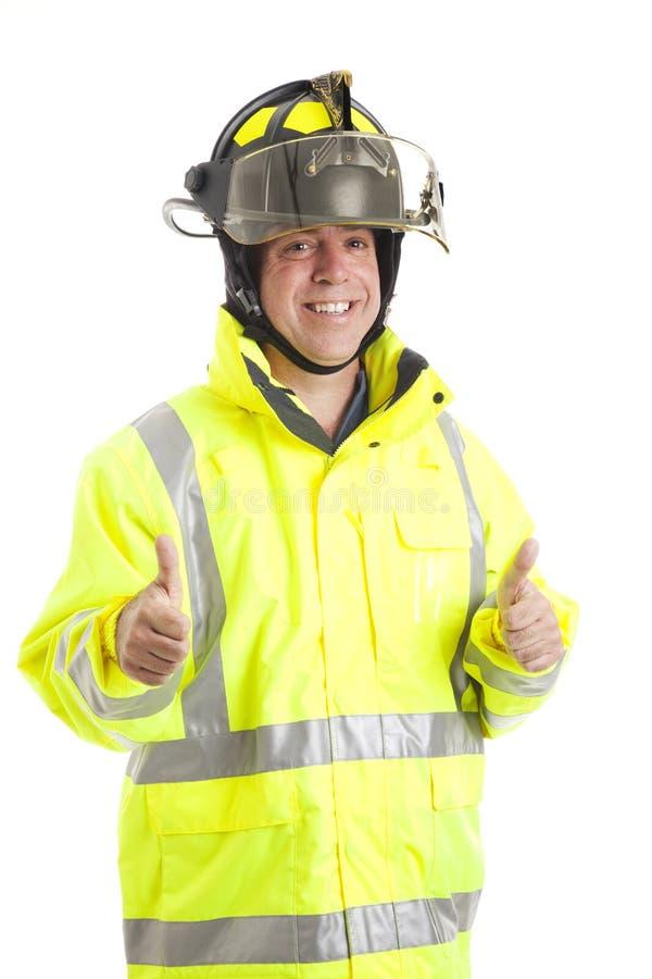 Sapeur-pompier - deux pouces vers le haut image stock