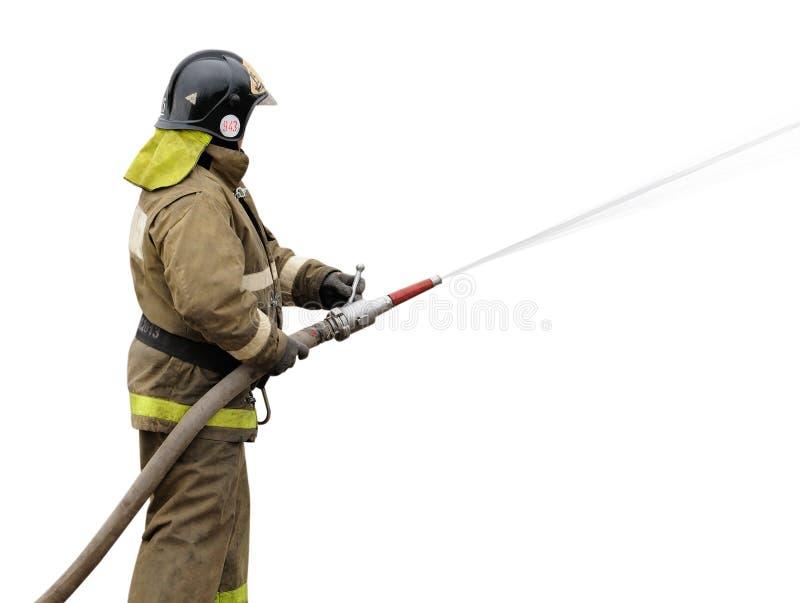 Sapeur-pompier travaillant avec la lance à brouillard image libre de droits