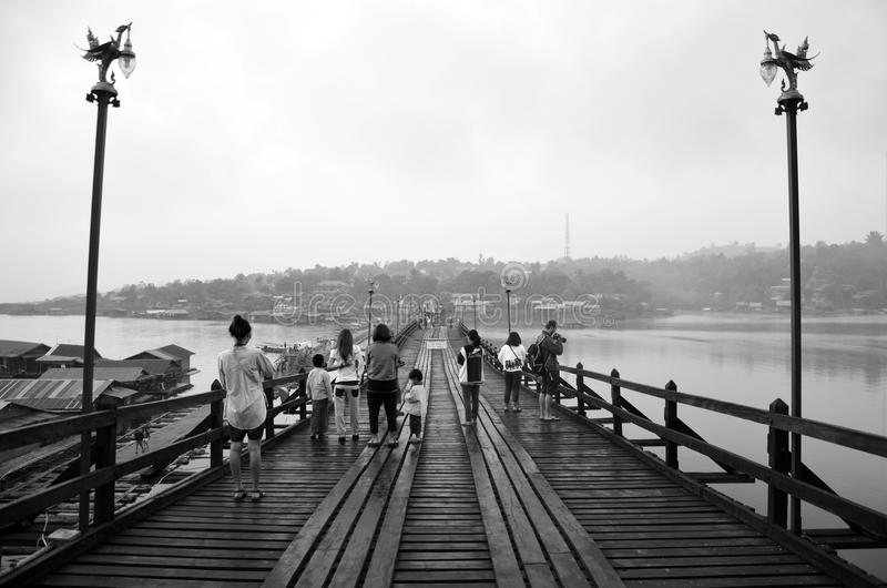 Saphan Mon Wooden Bridge in morning. This picture shooting photo locatoin at Song Kalia River in Sangkhlaburi, Kanchanaburi Province Thailand. Today stock photo