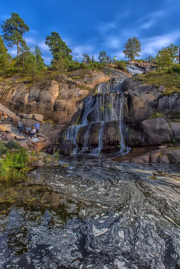 Sapokka Park in the city of Kotka in Finland. Waterfall with a cliff on the background of the lake. Finland, Kotka 17,08,2019 Sapokka Park in the city of Kotka stock image