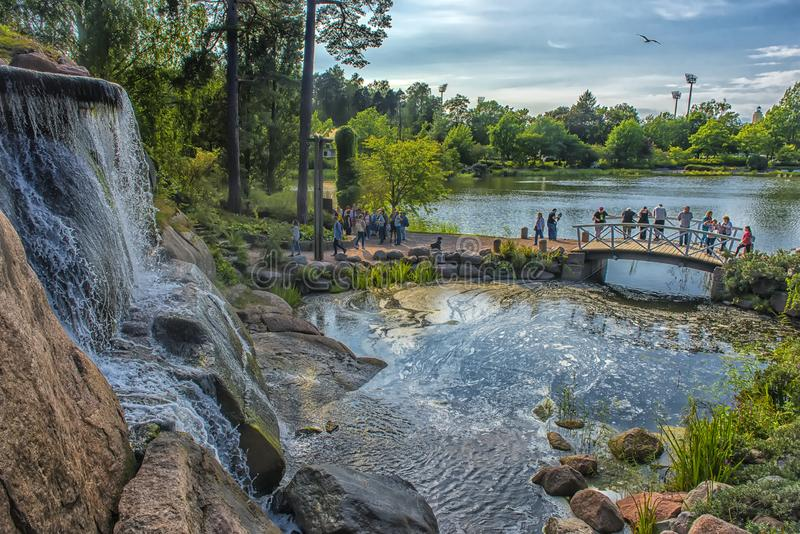 Sapokka Park in the city of Kotka in Finland. Waterfall with a cliff on the background of the lake. Finland, Kotka 17,08,2019 Sapokka Park in the city of Kotka stock photos