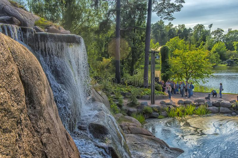 Sapokka Park in the city of Kotka in Finland. Waterfall with a cliff on the background of the lake. Finland, Kotka 17,08,2019 Sapokka Park in the city of Kotka royalty free stock images