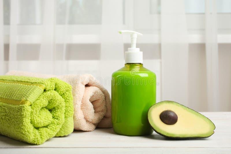 Sapone della mano con l'avocado fotografia stock