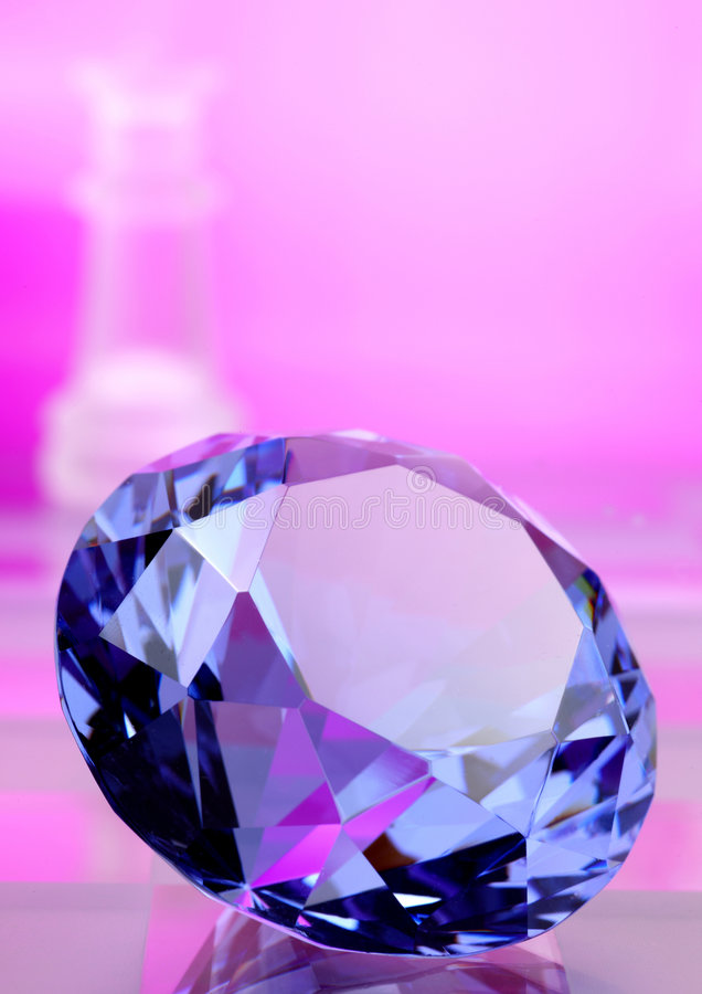 Sapphire stone. Highlighted with queen on chess board royalty free stock photography