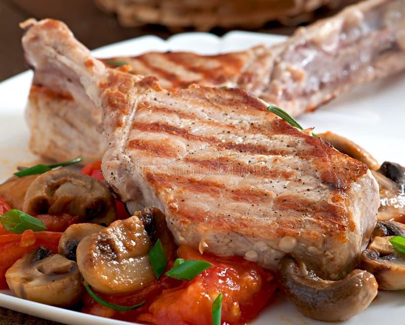 Sappig geroosterd varkensvleeslapje vlees stock afbeelding