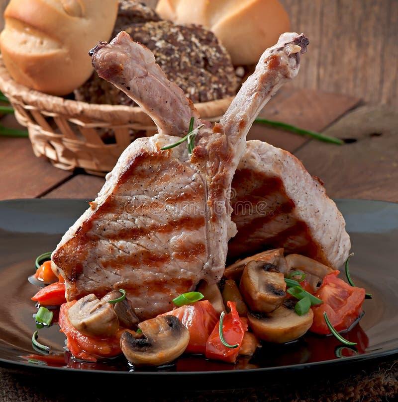 Sappig geroosterd varkensvleeslapje vlees royalty-vrije stock afbeeldingen