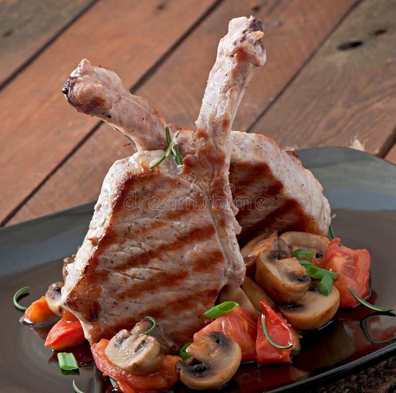 Sappig geroosterd varkensvleeslapje vlees stock fotografie