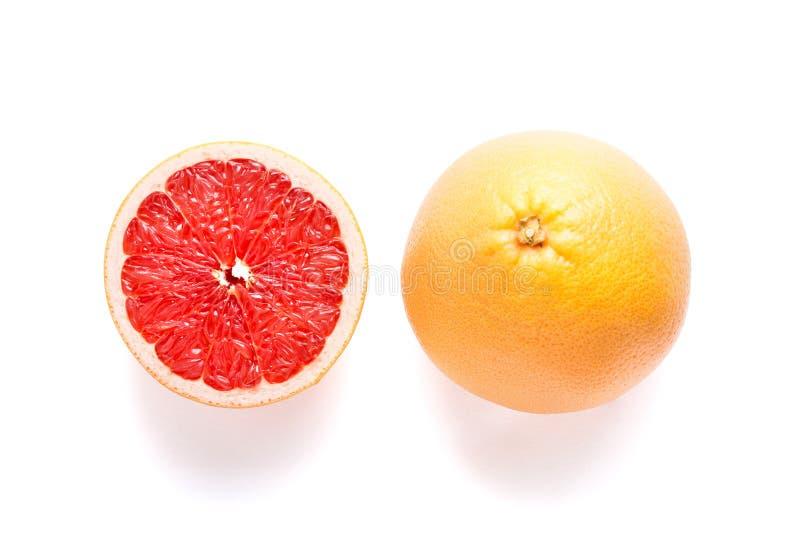 Sappige grapefruit op witte achtergrond stock afbeeldingen