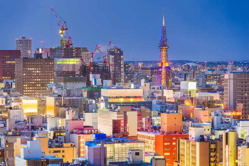 Sapporo, Japan downtown cityscape at dusk. Sapporo, Hokkaido, Japan downtown cityscape rooftop view at night royalty free stock photography