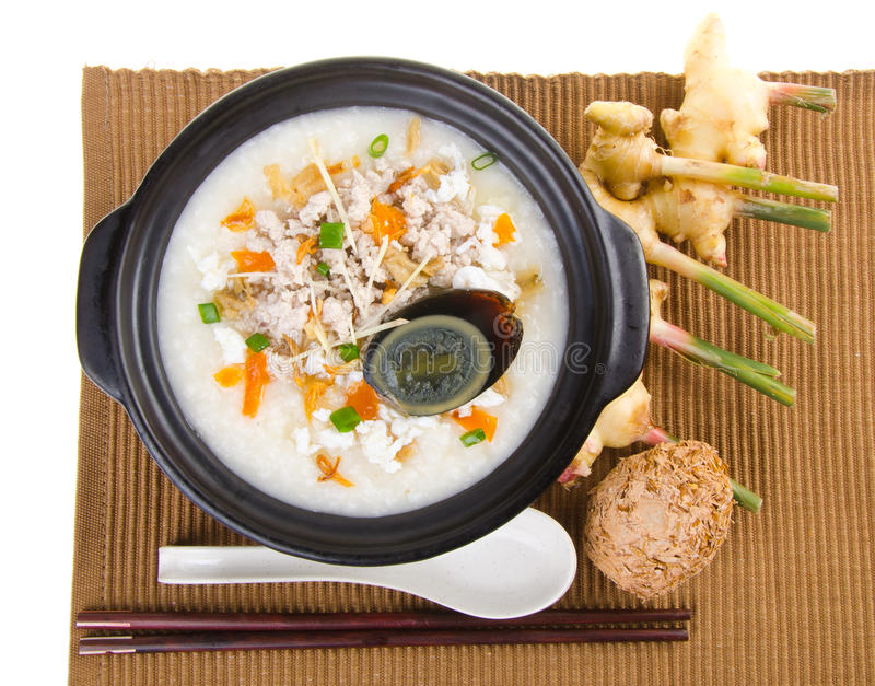 Saque do mingau do arroz do papa de aveia do ovo & da carne de porco do século do chinês tradicional imagem de stock royalty free