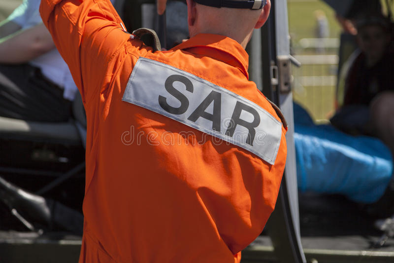 SAR Search and Rescue logo on a pilot from a rescue helicopter. BERLIN / GERMANY - JUNE 3, 2016: SAR Search and Rescue logo on a pilot from a rescue helicopter royalty free stock images