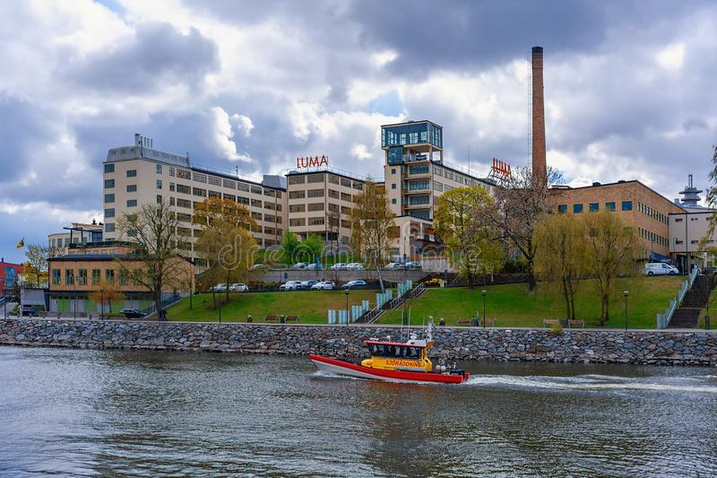 The SAR speed boat Rebecka af Odd Fellow passes underway of the canal Hammarby in Stockholm. Operated by The Swedish Sea Rescue stock photography