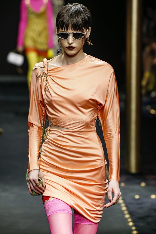 Sara Soric walks the runway at the Versace show at Milan Fashion Week Autumn/Winter 2019/20. MILAN, ITALY - FEBRUARY 22: Sara Soric walks the runway at the royalty free stock images