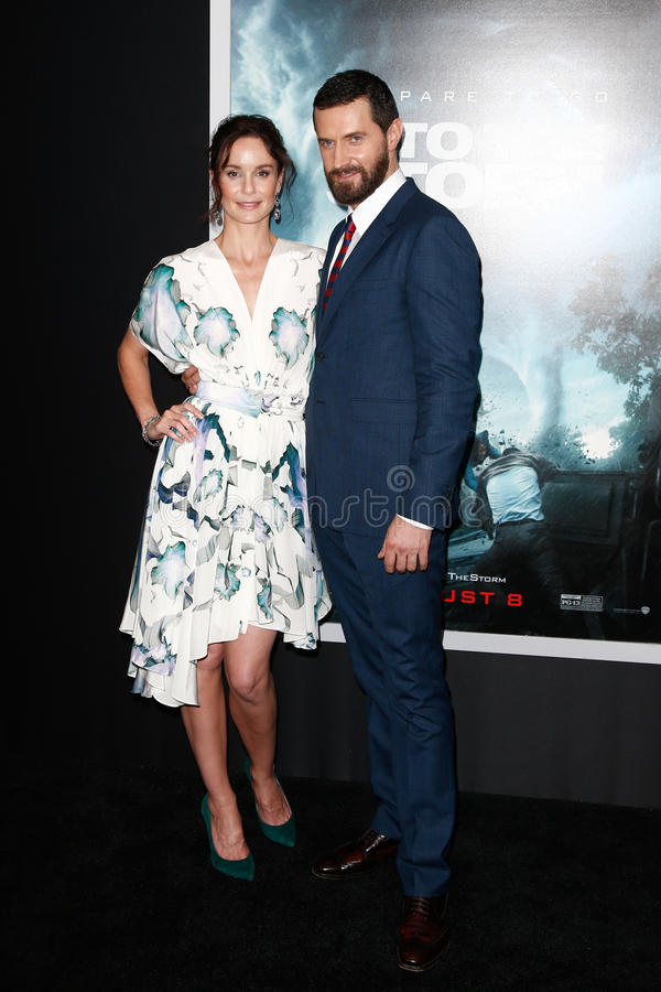 Sarah Wayne Callies, Richard Armitage. NEW YORK-AUG 4: Actors Sarah Wayne Callies and Richard Armitage attend the Into The Storm premiere at the AMC Lincoln royalty free stock photo