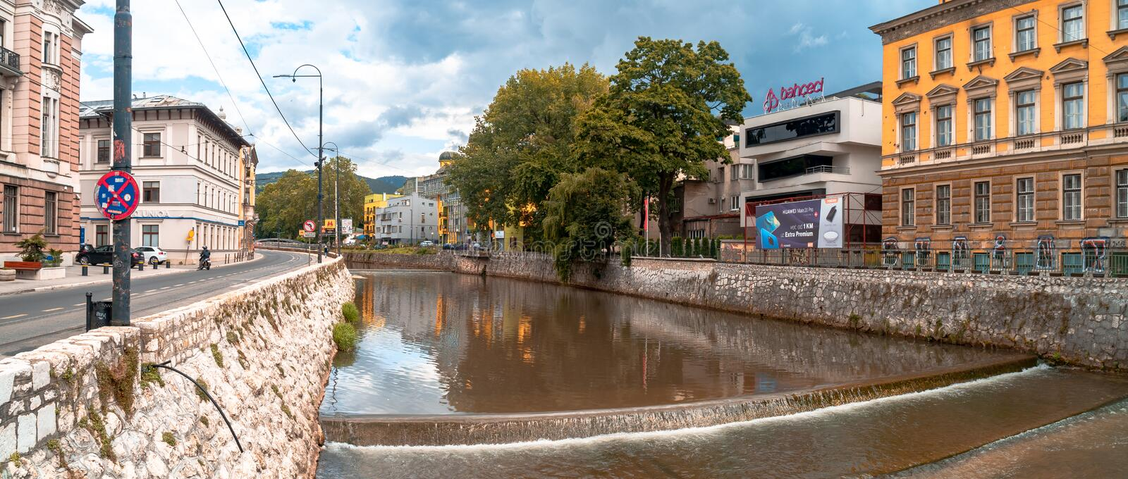 Miljacka River and Bridges in Sarajevo. SARAJEVO, BOSNIA - AUGUST 3, 2019 : Houses near Miljacka river and bridges. The old town is most popular place for royalty free stock photography