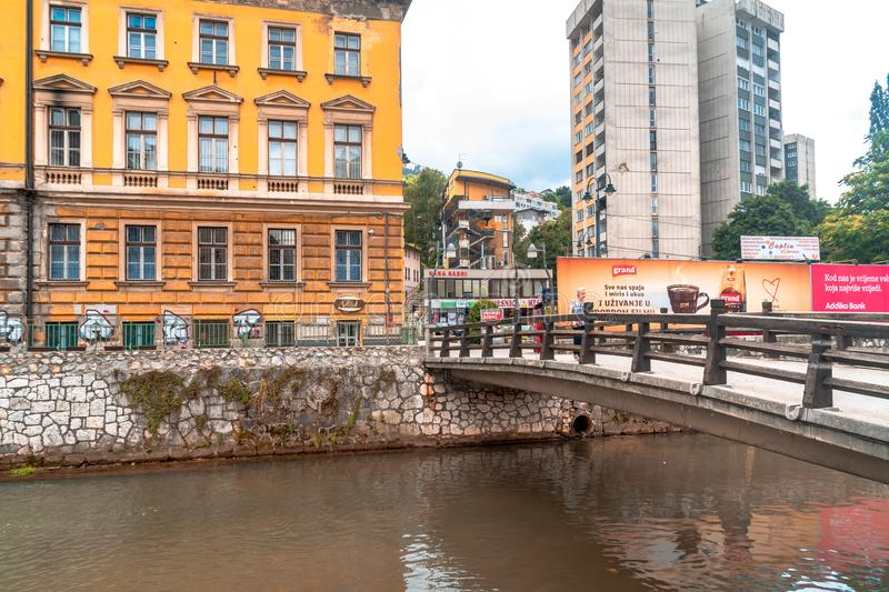Miljacka River and Bridges in Sarajevo. SARAJEVO, BOSNIA - AUGUST 3, 2019 : Houses near Miljacka river and bridges. The old town is most popular place for stock photos