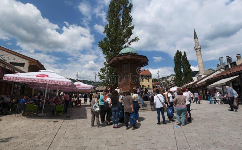 Sarajevo, Bosnia and Herzegovina, Bascarsija, Sebilj, fountain, old town, square, mosque, minaret, skyline, bazaar, market. Sarajevo, Bosnia and Herzegovina stock photo