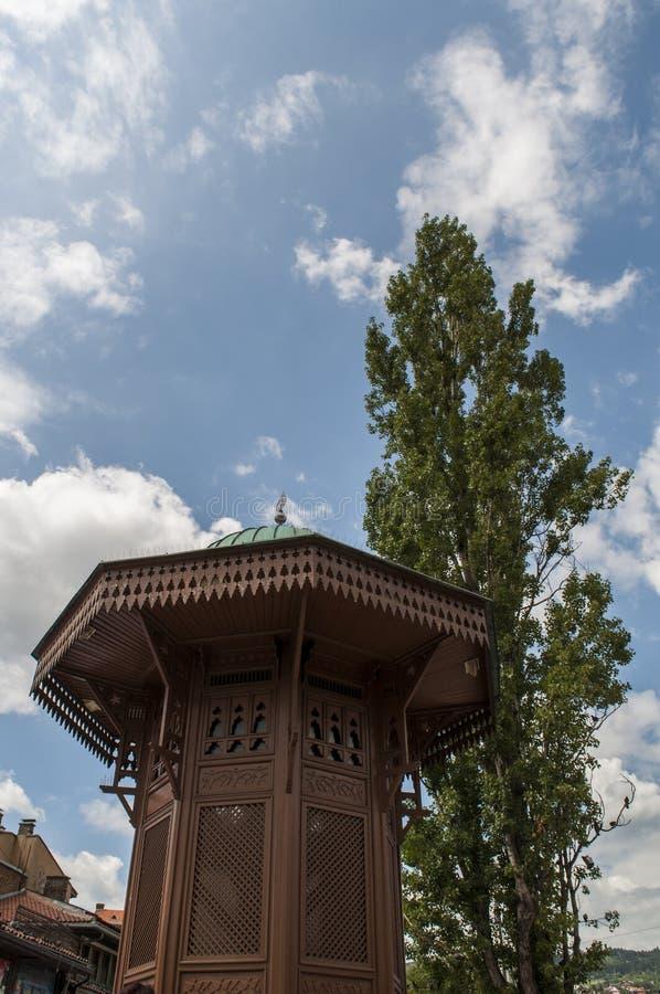 Sarajevo, Bosnia and Herzegovina, Bascarsija, Sebilj, fountain, old town, square, mosque, minaret, skyline, bazaar, market. Sarajevo, Bosnia and Herzegovina: the stock photo