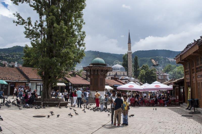 Sarajevo, Bosnia and Herzegovina, Bascarsija, Sebilj, fountain, old town, square, mosque, minaret, skyline, bazaar, market. Sarajevo, Bosnia and Herzegovina royalty free stock images