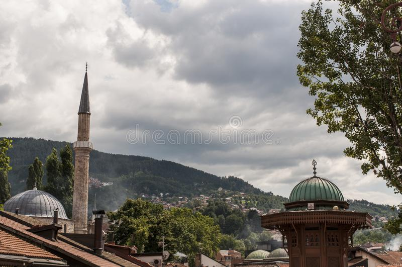Sarajevo, Bosnia and Herzegovina, Bascarsija, Sebilj, fountain, old town, square, mosque, minaret, skyline, bazaar, market. Sarajevo, Bosnia and Herzegovina stock photos