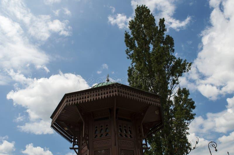 Sarajevo, Bosnia and Herzegovina, Bascarsija, Sebilj, fountain, old town, square, mosque, minaret, skyline, bazaar, market. Sarajevo, Bosnia and Herzegovina: the royalty free stock photos