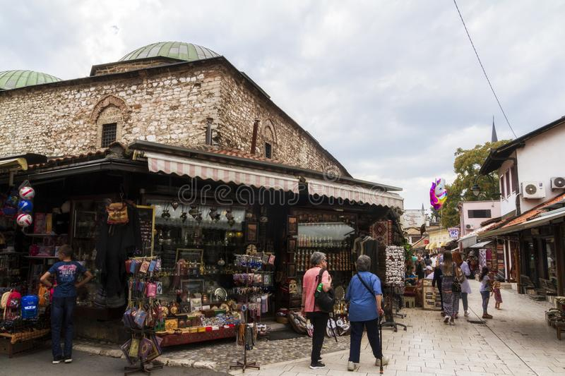 Pedestrian market area of Bascarsija in Sarajevo, Bosnia. Bascarsija, the old town, is a popular place for tourists to buy local c. SARAJEVO / BOSNIA AND royalty free stock photography