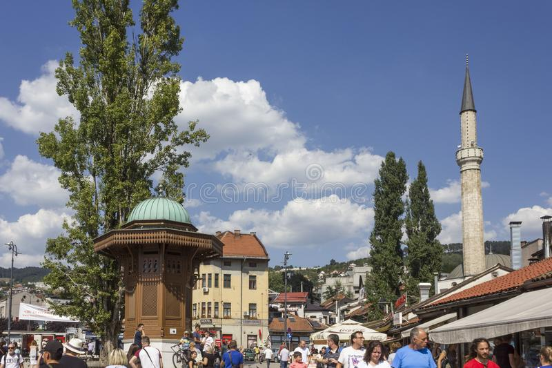 Sarajevo city centre at day time in summer season, with the sebilj fountain and people around stock image