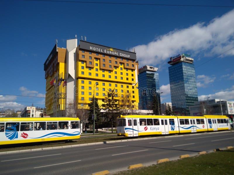Sarajevo street photo with yellow building and tram royalty free stock photos