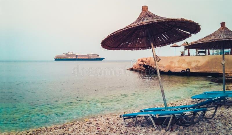 Saranda beach, Albania, beautiful seascape with cruise ship on sunset royalty free stock images
