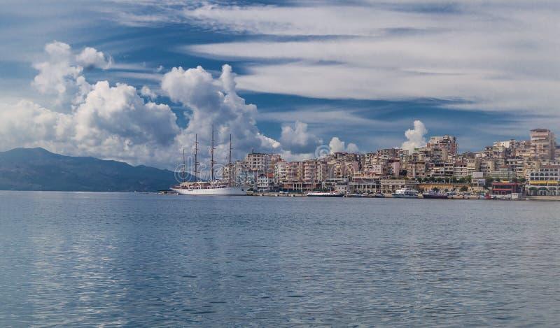 Saranda city port at ionian sea. Albania. Sarande. Beautuful view, white ship, yacht, sea, clouds in the sky stock photo
