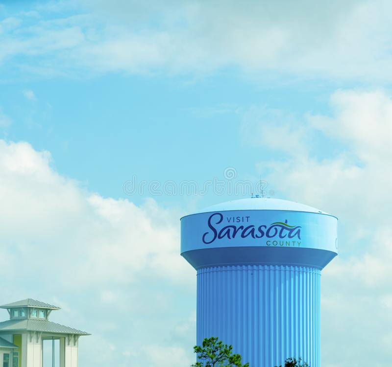 Visit Sarasota County written on a clue water tower. Sarasota, USA - February 24, 2019: Visit Sarasota County written on a clue water tower, community, demand stock photo
