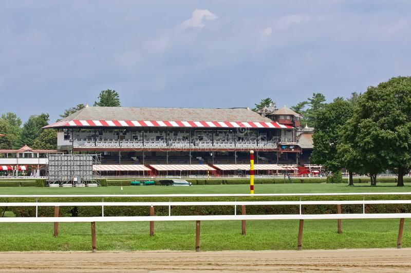 Saratoga Clubhouse. A lovely view of the Saratoga Clubhouse from the backstretch. Since 1863, Saratoga racecourse is the oldest track in the country. Lined with stock photo
