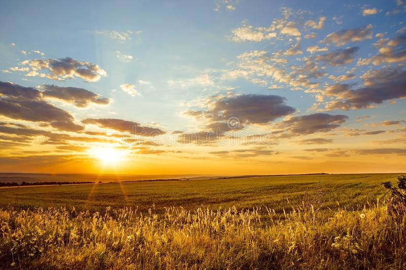 Saratov region, travel, landscape and nature of Russia. Yellow golden orange dramatic beautiful sunrise at dawn or dusk over. Endless fields, hills and meadows royalty free stock images
