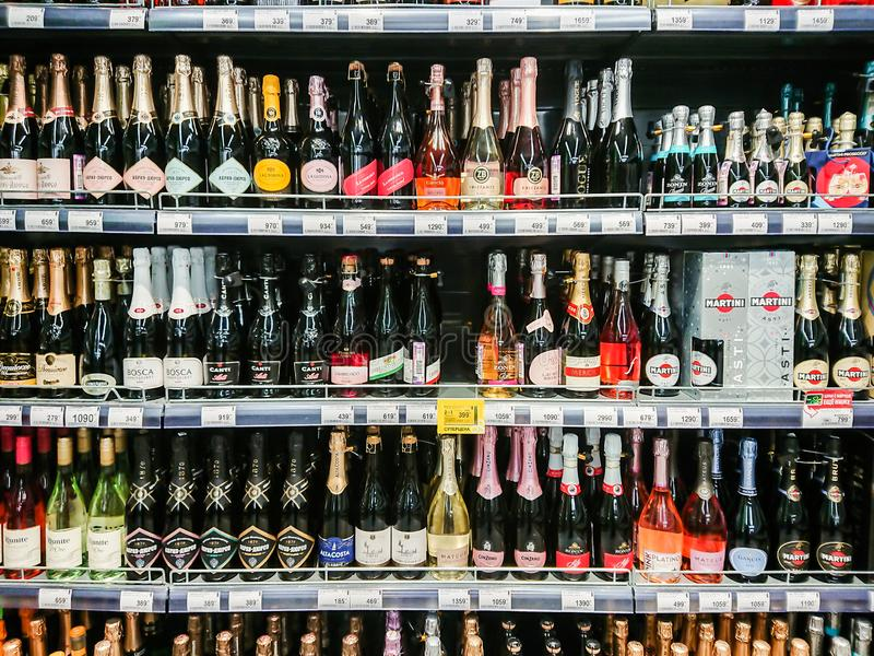 Different brands of sparkling wines and champagne on the shelves. stock photo