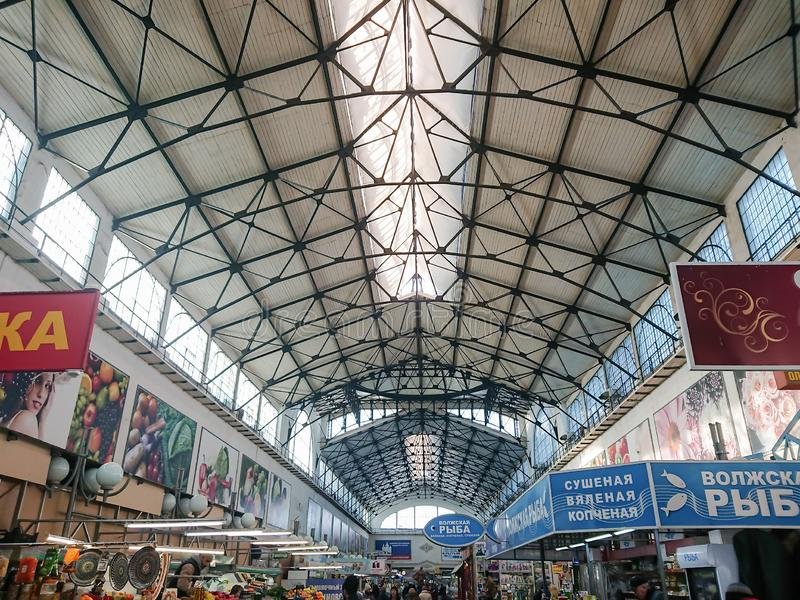 Saratov / Russia - January 26, 2019: Covered market. Ancient building, built in 1916. Sale of various food products. People, buyers and sellers royalty free stock photos