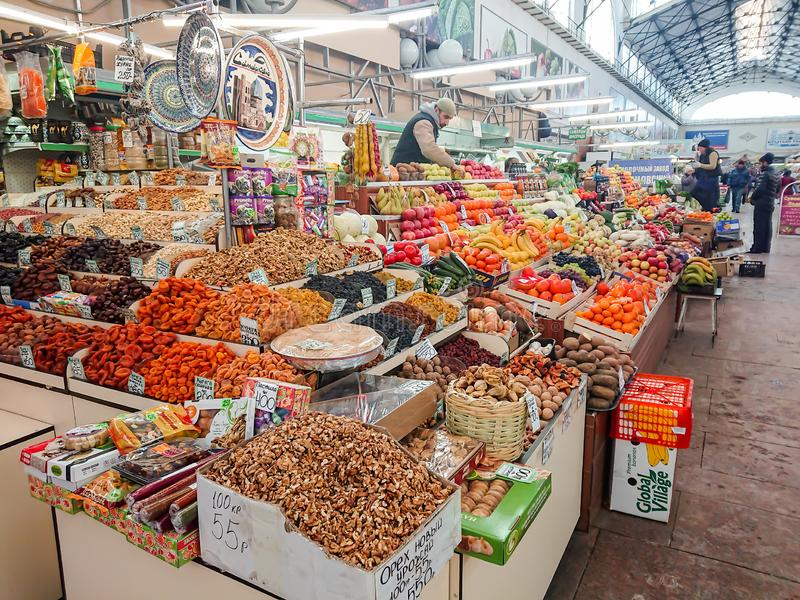 Saratov / Russia - January 26, 2019: Covered market. Ancient building, built in 1916. Sale of various food products. People, buyers and sellers stock photo