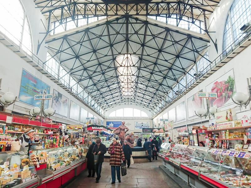 Saratov / Russia - January 26, 2019: Covered market. Ancient building, built in 1916. Sale of various food products. People, buyers and sellers stock photos