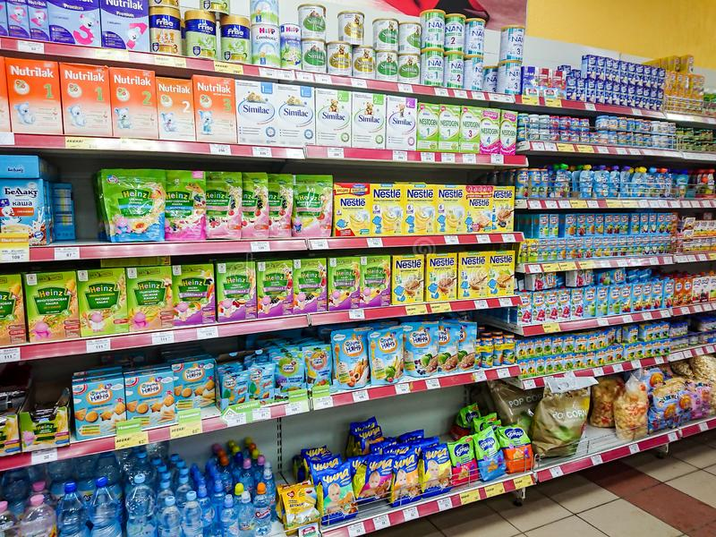 Goods on the shelf of a grocery store. Different baby food. Saratov / Russia - January 2, 2019: Goods on the shelf of a grocery store. Different baby food royalty free stock photos