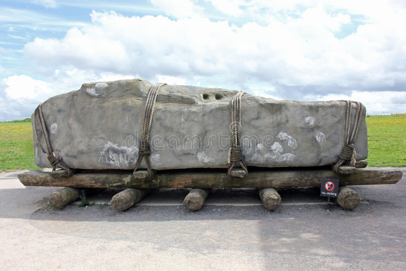 Sarsen rock resting on wooden rollers, Stonehenge, England. Monument at Stonehenge was built by neolithic people about 5000 years ago. The sarsen rocks, sand royalty free stock image