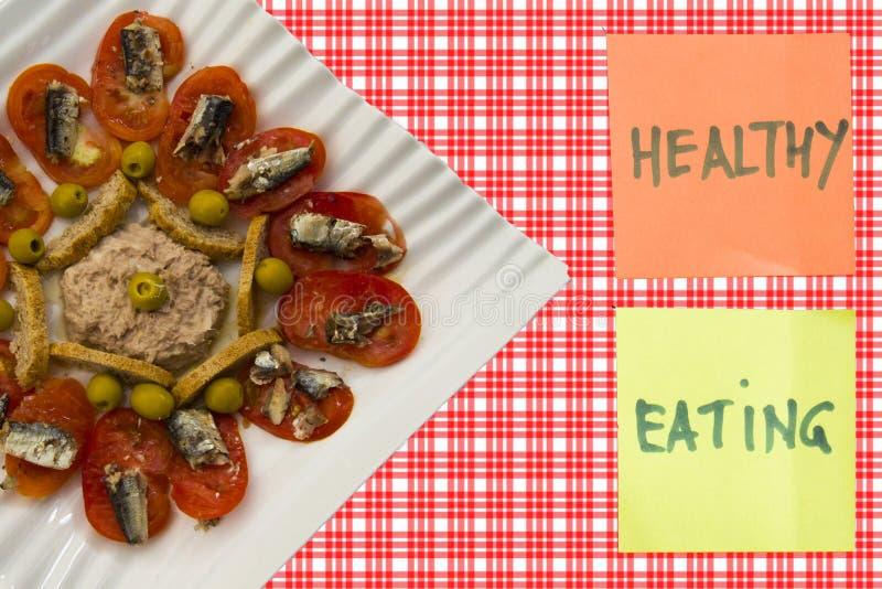Sardela, pomidor i oliwki, obrazy stock