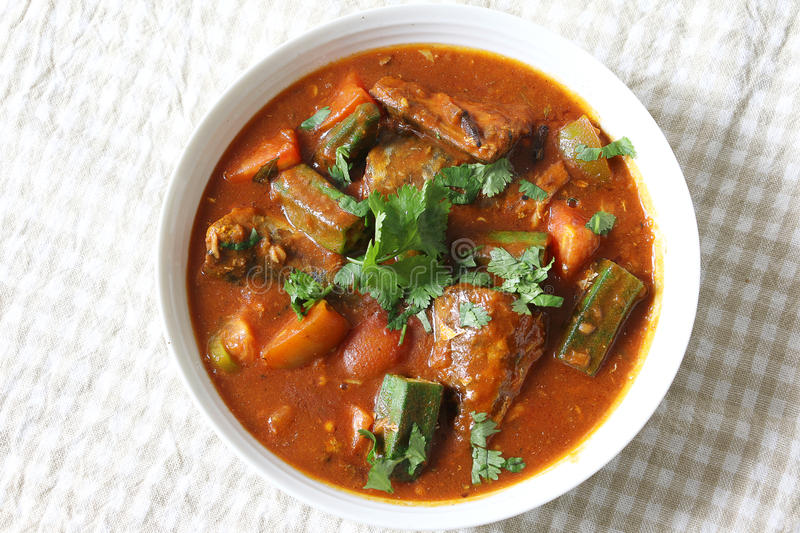 Sardine fish curry. South India cuisine, Sardine fish curry with tomato and Okra royalty free stock photos
