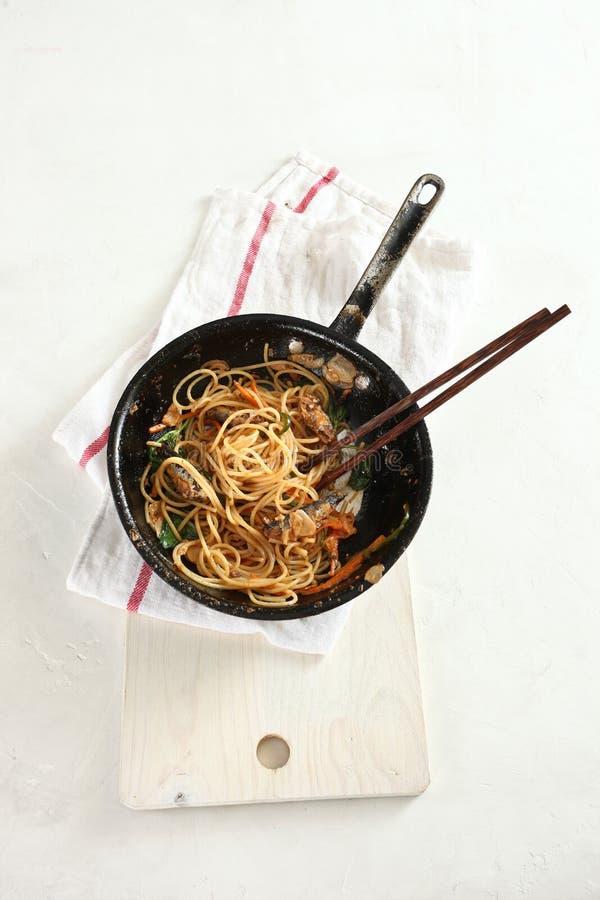 Sardine pasta in pan. On white background stock photos